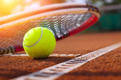 .tennis ball on atennis court